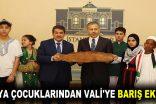 DÜNYA ÇOCUKLARINDAN VALİ'YE BARIŞ EKMEĞİ